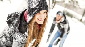 smiling-man-and-woman-in-the-snow-smaller-300x167.jpeg